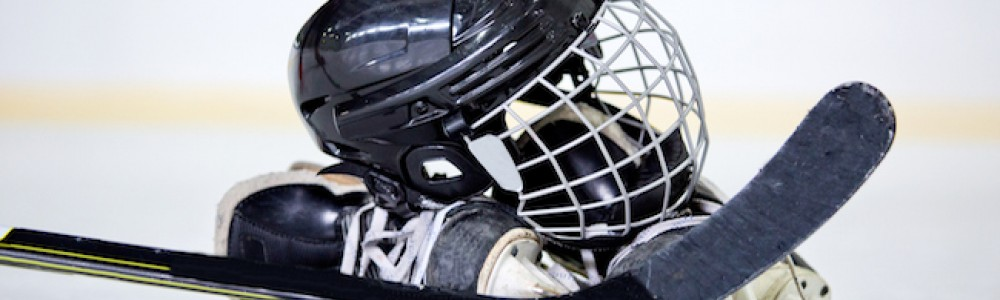 Ice hockey gear on the ice in rink