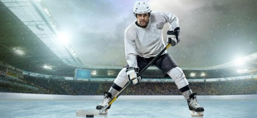Ice hockey player ready on ice