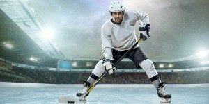 Ice hockey player ready on ice