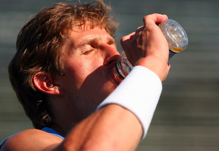 Igor Andreev drinking out of bottle