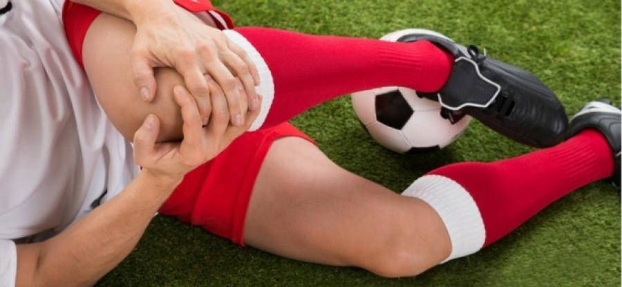 Injured football player on grass