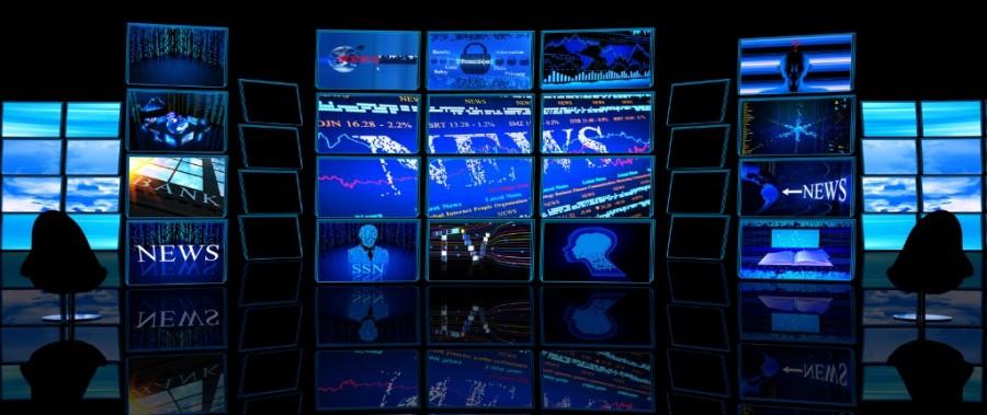 Multiple TV Screens Display News In Dark Studio
