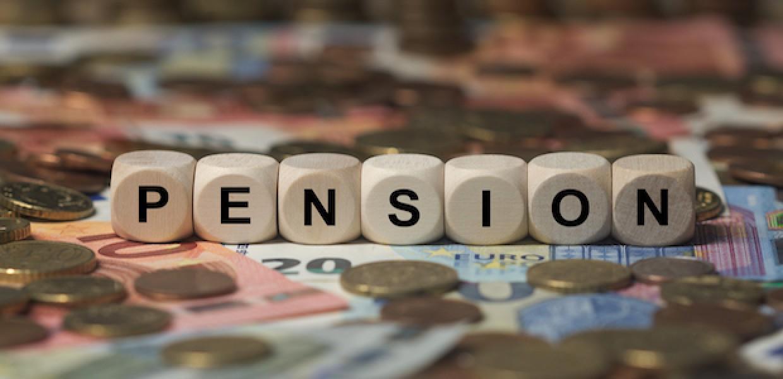 Pension written in block letters on money