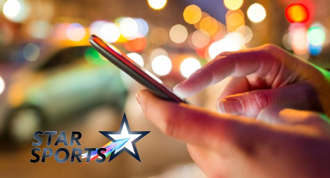 Person_Using_Mobile_in_Street_With_STAR_Sports_Logo