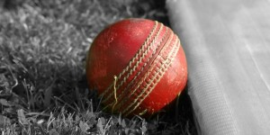 Red_Cricket_Ball_on_Grey
