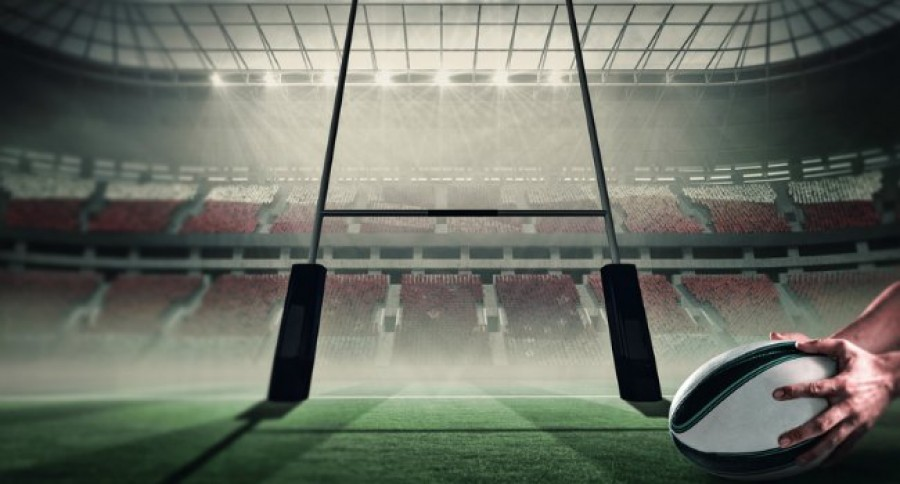 Rugby_Player_Holding_Ball_in_Front_of_Goal