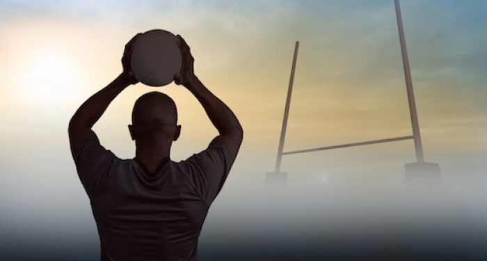 Rugby player on field with ball in mist