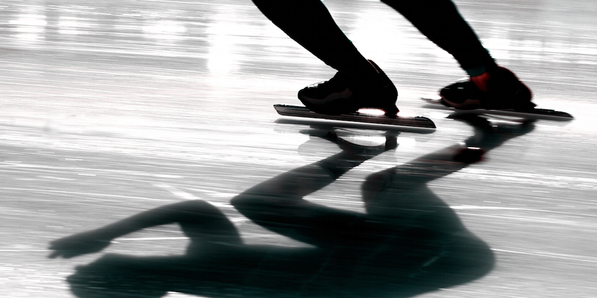 Speedskater with a reflection on ice