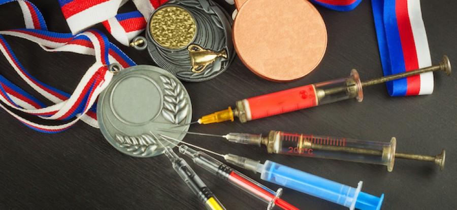 Syringes in medals on desk