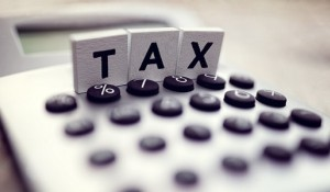 Tax spelled out in block letters on top of calculator