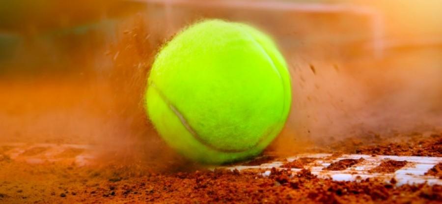 Tennis Ball hitting the dirt