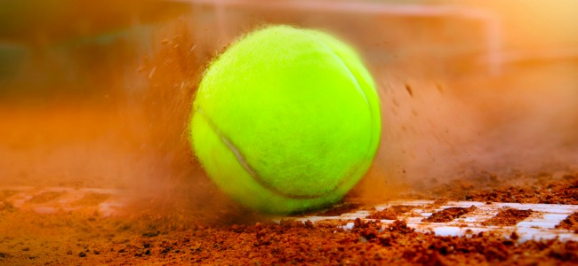 Tennis Ball hitting the dirt