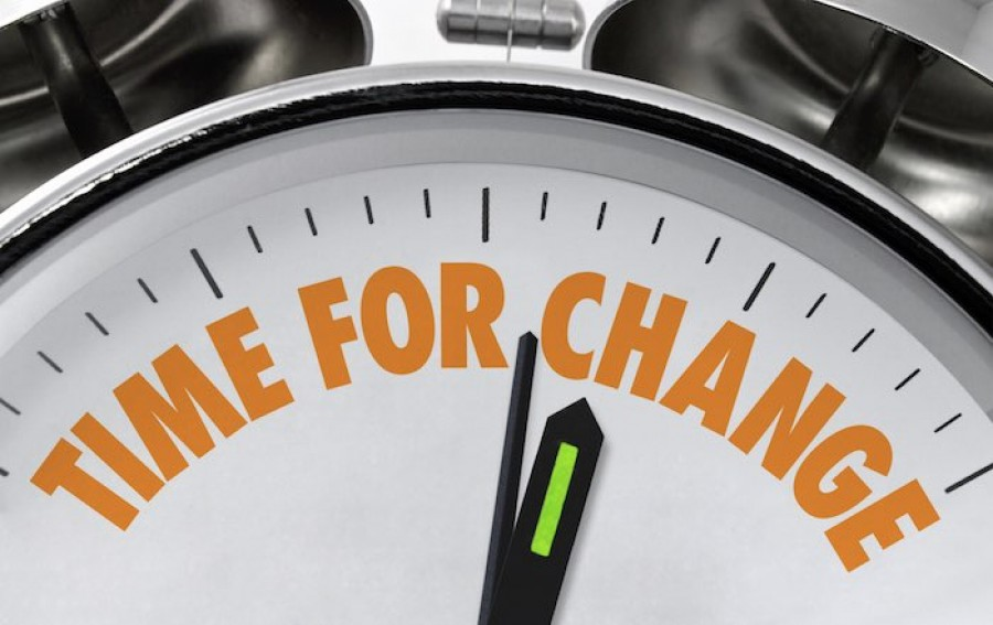Time for change written on clock face