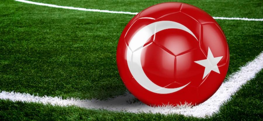 Turkey flag on football on field