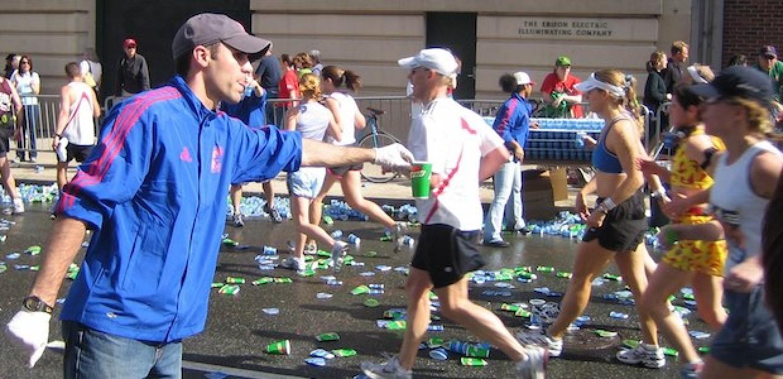 Volunteer handing out water