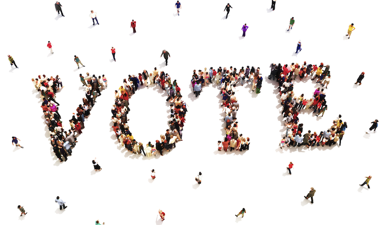 People joining together to spell the word vote