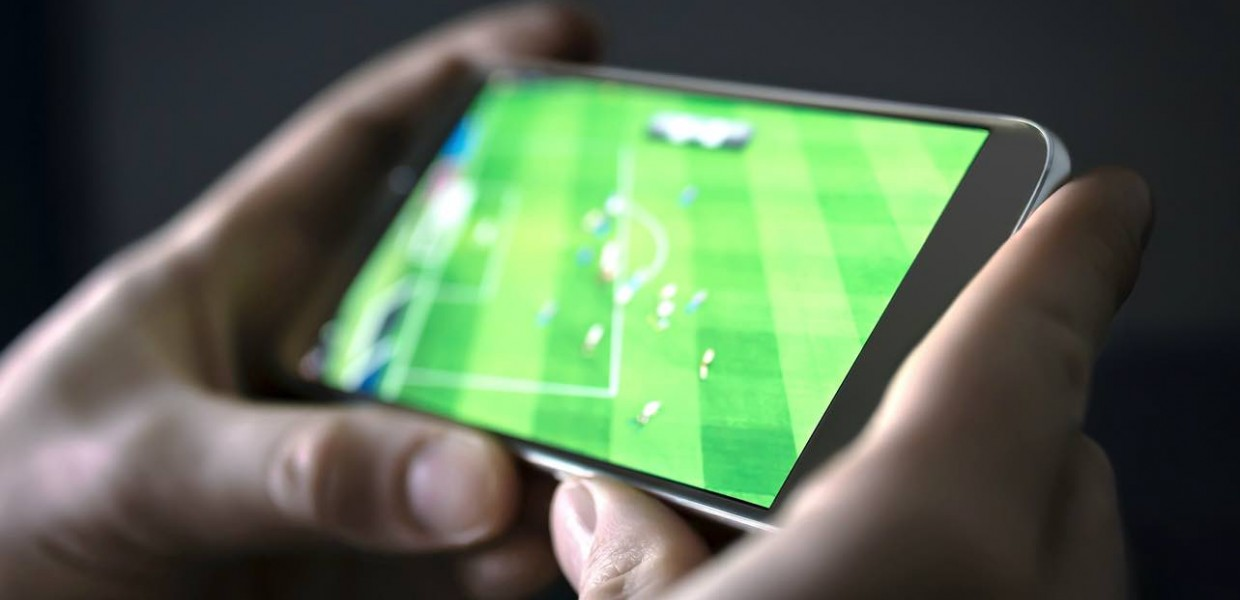 Man watching football on phone