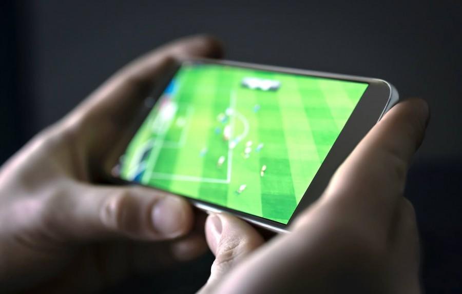 Man watching football on phone