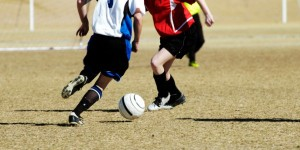 Young_Footballer_Going_for_the_Ball