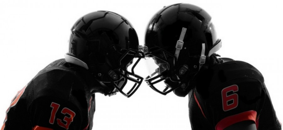 American football players in helmets