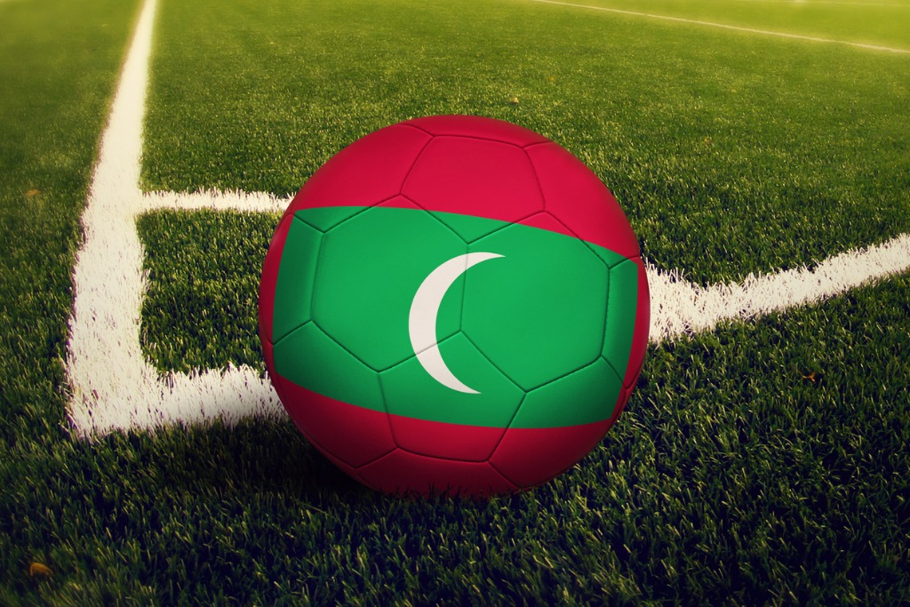 Ball On Corner Kick Position On Soccer field with Maldives Flag On Ball