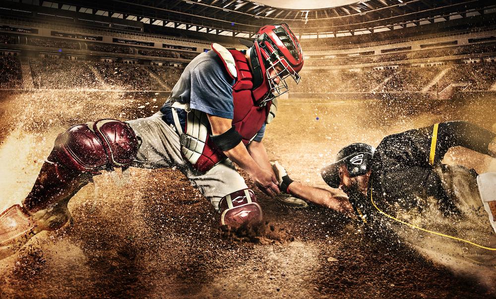 Baseball player sliding for home base