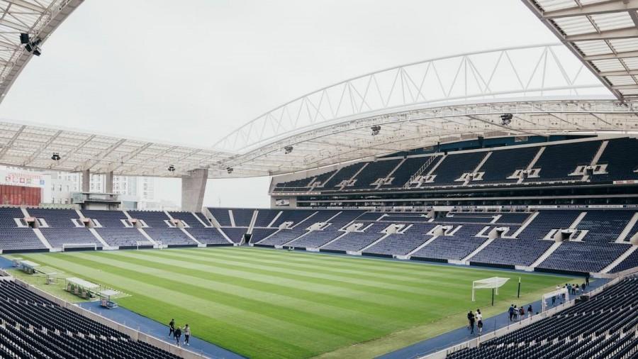 Image of empty stadium with blue seats