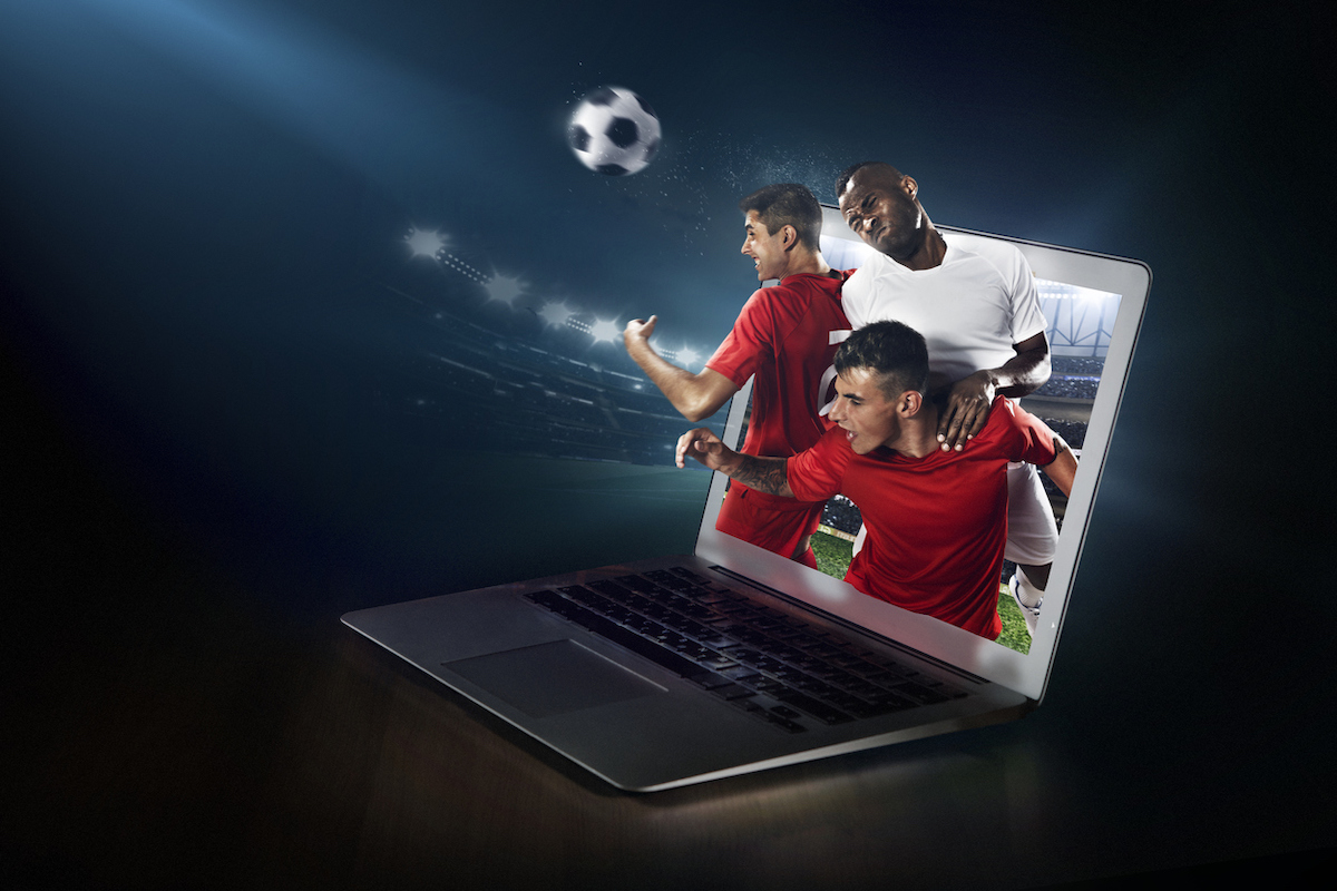 Laptop Screen Showing Players Playing Football