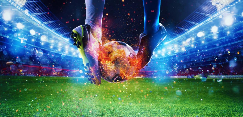 Football Players kicking flaming football