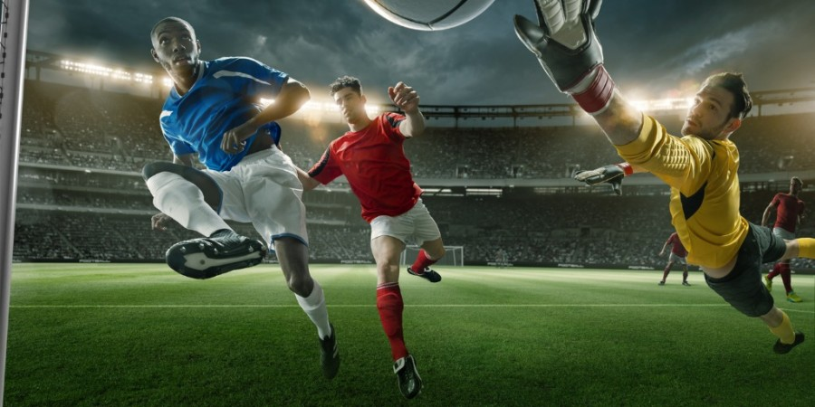 Goalmouth View of Soccer Player Scoring With Midair Volley