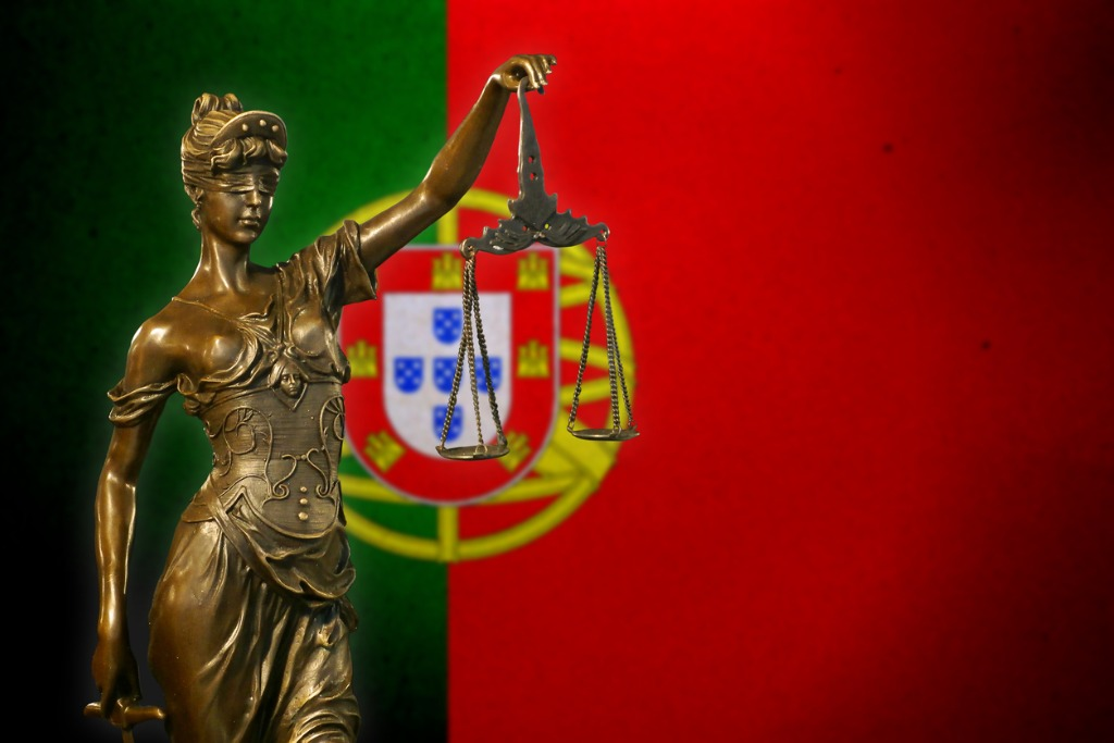 Lady Justice In Front of Portuguese Flag