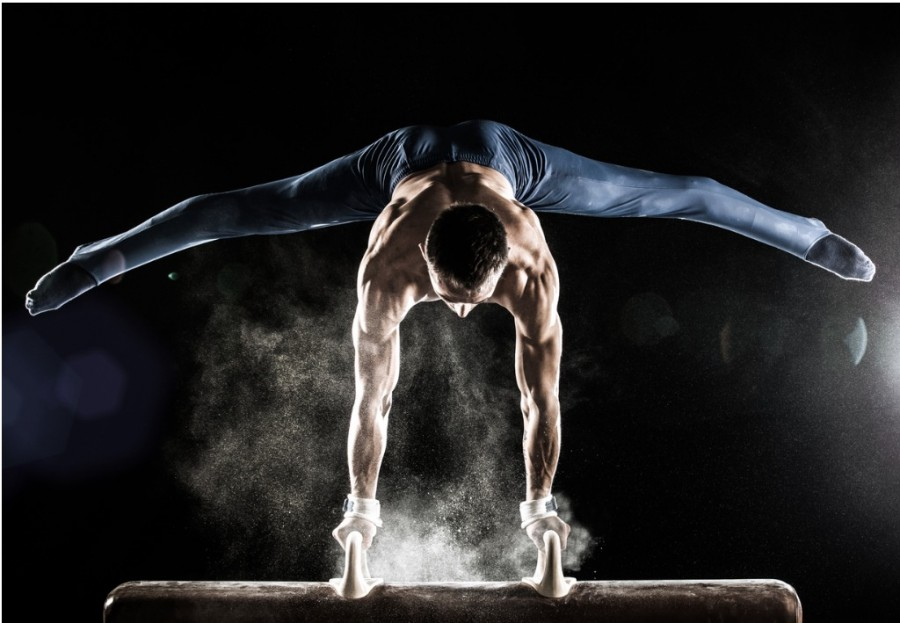 Male Gymnast Doing Handstand On Pommel Horse