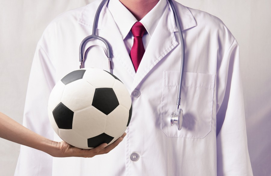 Football in front of white coat