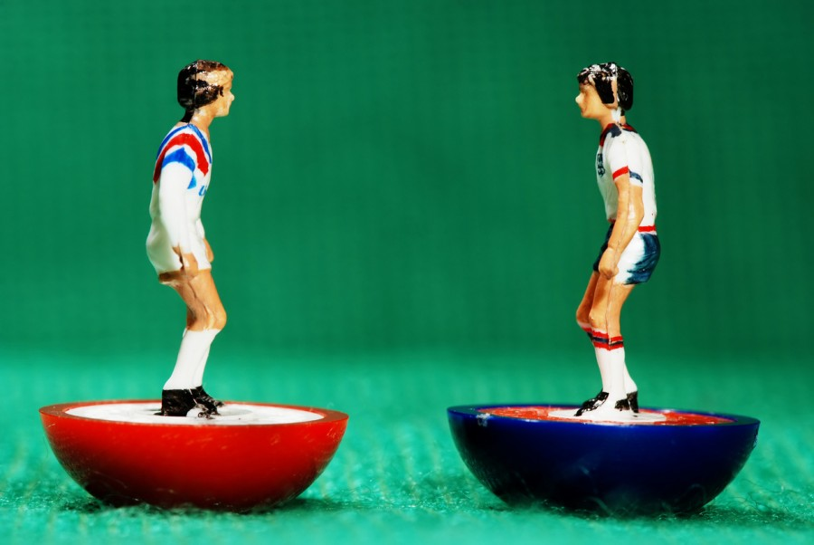 American and English Subbuteo figurines facing each other