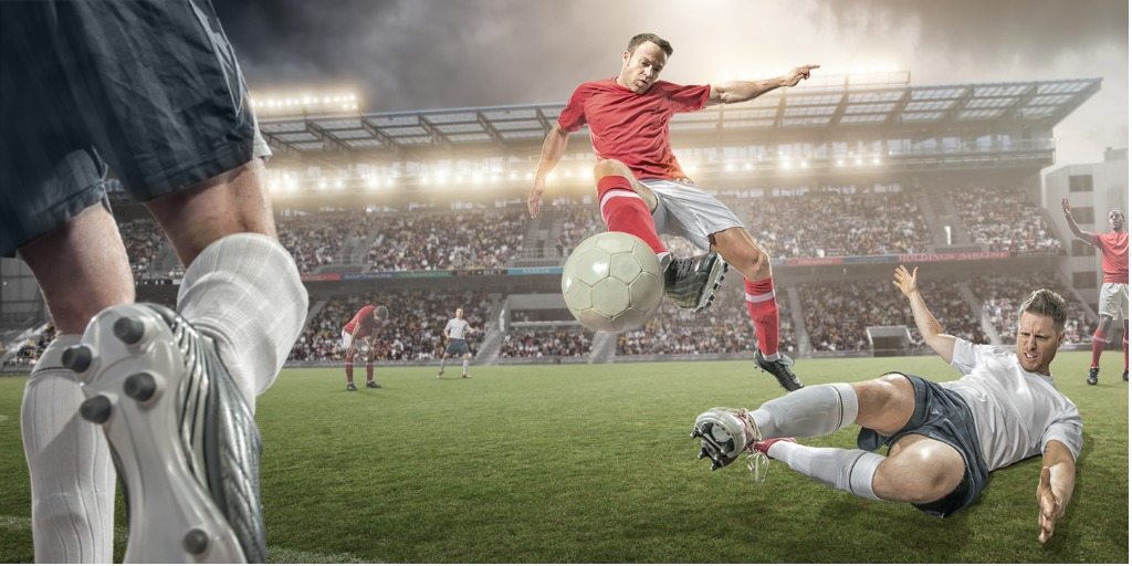 Title image - Football player kicking the ball past a defender