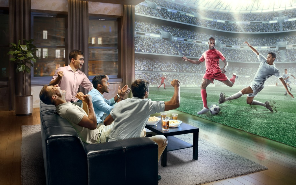 People Watching Realistic Football on TV
