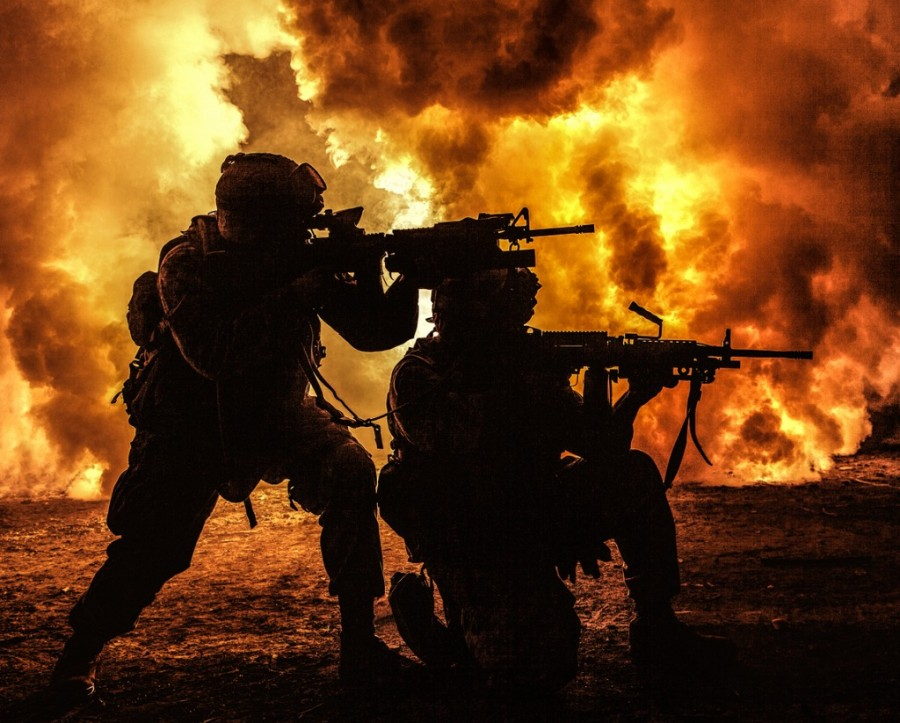 Title images - two soldiers in battle surrounded by flames and smoke